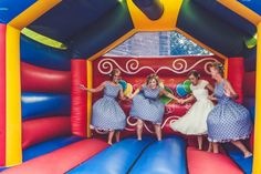 Moon bounce with the bridal party - so awesome | Image by Claire Penn Photography