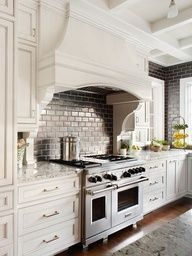 Love these dark tiles and the range hood.  Blue subway tile featured in Better Homes & Gardens.