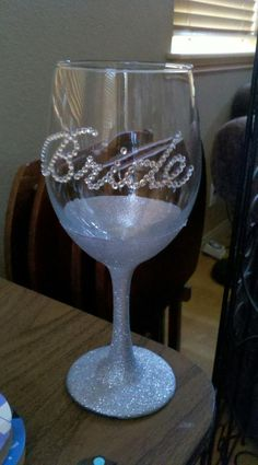 Bride Wine glass we made for my cousins bridal shower Glitter Spray paint and a rhinestone bride sticker..its that easy