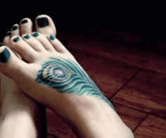 Google Image Result for http://slodive.com/wp-content/uploads/2012/03/foot-tattoos-for-girls/peacock-wing.jpg