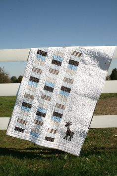 Baby quilt - change the single appliqué motif and it's anyone's quilt.