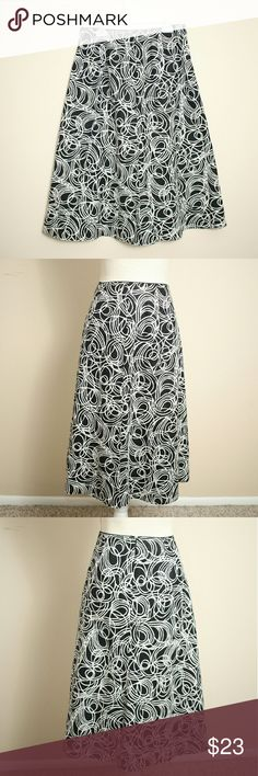 "Talbots Black and White Print Linen Skirt Size 6 Beautiful women's size 6 black and white printed A-line skirt from Talbots Petites. With side zip and fully lined. Exterior 55% linen, 45% cotton. Lining 100% cotton. Like-new. From office to outing, you'll be comfortable donning this classic black and white skirt anywhere and everywhere. Retail $75.  ℹ Waistline approx. 28"", laid flat ℹ Skirt length 27"" Talbots Skirts"