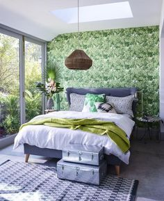 Exotic foliage prints, vivid green hues and rich wood tones create a verdant scheme. Use several shades of green and offset them with blocks of white. A pared-back jute lampshade stands out against the dramatic, tropical-leaf wallpaper. Bedroom Themes, Bedroom Colors, Home Decor Bedroom, Bedroom Ideas, Bedroom Inspiration, Asian Home Decor, Quirky Home Decor, Diy Home Decor, Asian Bedroom