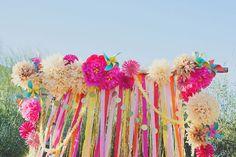 colorful pompom and streamer ceremony backdrop