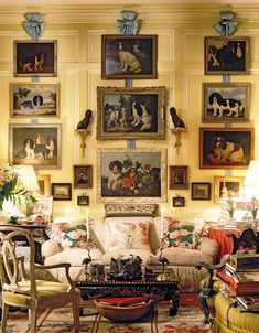 "Although he's never owned a dog of his own, Buatta has decorated his living room with portraits of pups, whom he calls his ""ancestors."""