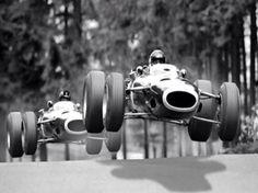 1960's Formula 1. Jackie Stewart leads Graham Hill in 1966 German GP at Nurburgring.