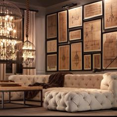 May I start to say what a ballsy move of the large focal wall of large pictures, but it works! The (ALL OVER) ivory tufted sofa is also such a piece that makes a bold statement to the contrast of all the lighting themes of this space. Well Done!