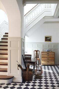 wall paneling, checkered floor.