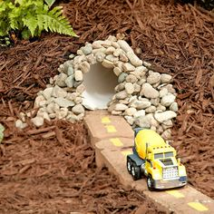 What great fun this would be. Make a tunnel for the kid's toy cars and trucks using PVC pipe, a few river rocks and some mulch. The brick road with painted line