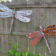 dragonfly yard art made from table legs and old ceiling fan blades: genius