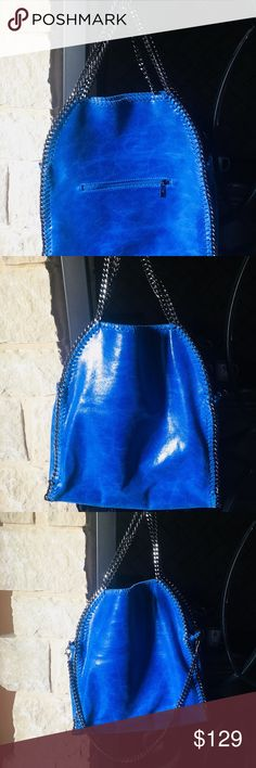 Gorgeous Cobalt Blue Italian Leather Bag. Beautiful buttery Italian Leather Bag in cobalt blue w/ gun metal chain that's just stunning to see & touch! It's cream on the inside & never  used. It has three Gunmetal chain handles and I have shown how you can carry with two & let 3rd one drop or even unhook it and remove 3rd one. I'm sad to sell but I'm trying hard to LET GO of all things sitting not being used and this purse is new without tags. Pocket on outside. Small zip pocket on inside…