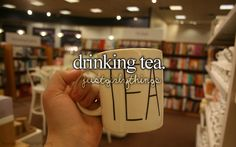 Tea with books in the background...I think this picture was taken in heaven!