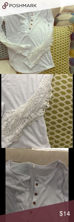 Very pale lavender/white L/S. Popover BOHO Elegant and fun ! Buttons 1/2 way down front. Beautiful detailed lace at elbows.  Runs big. Good stretch. Tag says medium.... Looks large. Tops Tees - Long Sleeve