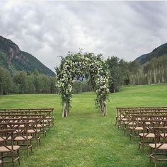 """Beautiful ceremony arch at The T Lazy 7 Ranch in Aspen, Colorado - a wedding venue with a ceremony """"Meadow"""" in the foreground of Pyramid Peak.  Photo: Jose Villa, Design: Easton Events, Florals: Mindy Rice"""