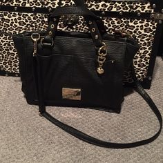 Juicy Couture purse Used once for a few hours. Perfect condition. Zero flaws. 3 compartments. Zip middle pocket. Gold hardware. 11 inches across and 9 inches tall. Comes with removable shoulder strap. Juicy Couture Bags Satchels