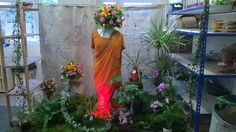 Indian Sumer window display by Libby and Laura. Level 2 Diploma Floristry.