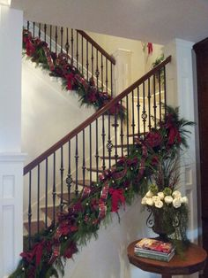 2013, fresh greenery with red and gold on the staircase.