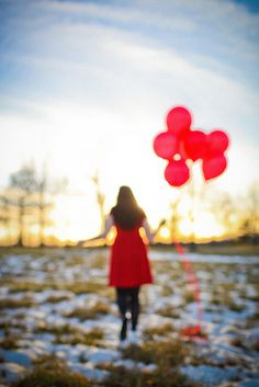 red balloons and snow