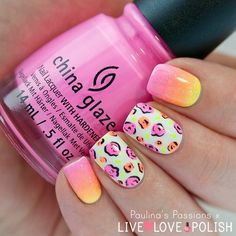 A pink nail art design with a summer feels to it. Additional colors such as yellow, orange and green are added to the gradient as well as on the flower details. White polish is used as base coat.