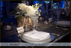 Winter wedding theme, birch wood, silver charger, silver bead plates, white hydrangea, blue uplights. Winter Wedding Snow Alexandria VA River Farm Photographer | jan michele photography