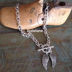 Danon silver necklace from Lizzielane features two intricately detailed angel wings http://www.lizzielane.com/.
