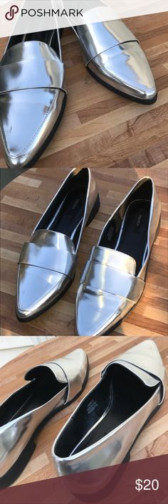 Forever 21 silver metallic pointed toe loafers Faux leather loafers by forever 21. Never been worn. A few small dinks from being in the closet, but in pretty good condition. There is a small scratch, and a small speck of orange on the side. It is pictured Size 10. Forever 21 Shoes Flats & Loafers