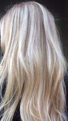 Blonde and platinum highlights. Long blonde hair with layers. Love this!