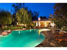 Exquisite gated, west side, single level home
