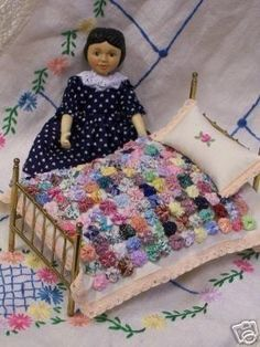 Love the little doll quilt!
