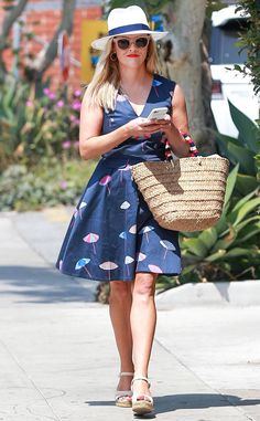 Reese Witherspoon from The Big Picture: Today's Hot Photos  Summer ready! The actress and mom puts her best foot forward while wearing her Draper James dress in Brentwood, California.