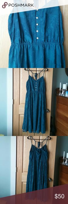"""💥SALE💥LC Dress LC Lauren Conrad Dress, size 12 NWOT! Never worn. Flowy and feminine, has a chiffon overlaid lining. Beautiful deep teal with button down front and flower applique type detail on the chiffon. Spaghetti straps that tie at the back. The waist has an elastic band but the dress does not have stretch to it. Approximate measurements Bust 17"""" Waist 14 1/2"""" unstretched, 18"""" stretched Length from waist 27 1/2"""" lining, 28 1/2"""" chiffon LC Lauren Conrad Dresses Midi"""
