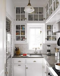 Beautiful light, small kitchen.  Perfect light fixture.