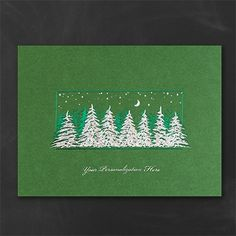 In the Moonlight Holiday Card - Front Imprint Evergreen trees embossed in prismatic silver foil are a striking addition to this solid green holiday greeting.