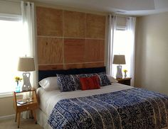 """""""I love the plywood panels behind our bed. It's a little bit rustic and a little bit modern. It was a $50 DIY that adds the warmth and architectural character that our builder-grade home lacks."""""""