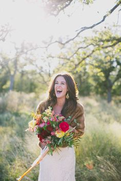 laughing bride, photo by Amber Vickery Photography http://ruffledblog.com/elegant-fall-wedding-ideas-from-texas #brides #weddingphotography