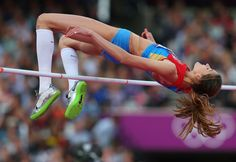 The Gold medal winner - Irina Gordeeva of Russia competes during the Women's High Jump Final wearing kinesiology tape!