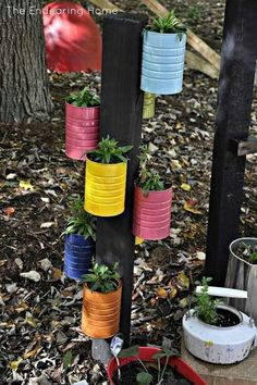 Make old soup cans into pot holders c; all you need is a few cans paint and something to screw it into the wall! Now be creatitive