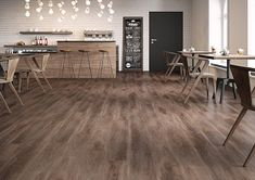 Create a beautiful open space with these gorgeous oak coloured wood effect tiles.