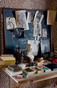"Rural house of the poet Jean Cocteau Cocteau gathered his favorite baroque mirrors and chairs, animal figures and screen ""Capito"", on which he had pinned pages from magazines"