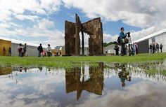 Ai Weiwei's installation, Template, is made out of the doors and windows of destroyed houses of the Ming and Quing dynasties. The photograph was taken after the official opening of the Documenta 12 art fair to the public in Kassel, central Germany.