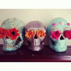 Hold a craft night with your ladies to #DIY some Day of the Dead party decor, like these glitter and paper flower skulls! #dayofthedead