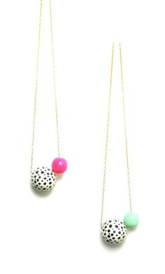 Because why not?    A splash of Polka Dots on a Large Bead ( 1.5 ) paired with either Hot Pink or Mint and strung on a metal link chain. Perfect for