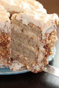 Banana Cake with Praline Filling and White Chocolate - Paired with sugary pecans and a whipped cream frosting lightly flavored with white chocoalate, this cake received thumbs up from all who tasted it..