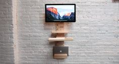 The StandCrafted minimalist, modular, wall-mounted standing desk in maple hardwood
