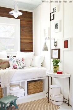 Cottage Guest Bedroom with Stikwood Reclaimed Barrel Oak, Reclaimed wood wall, Ikea - branas basket, Built-in day bed