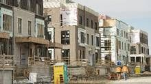 A townhouse complex is under construction in Toronto on Thursday, November 3, 2016. (Nathan Denette/THE CANADIAN PRESS)