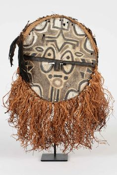 Africa   'Kidumu' mask from the Téké-Tsaayi people of DR Congo   Wood, feathers, natural fiber and pigments