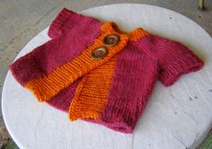 A short sleeved baby cardigan featuring cap sleeves, low yardage, and big buttons.