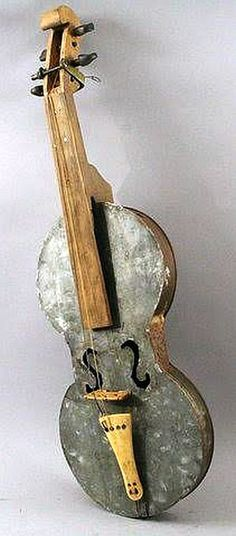 FABULOUS HAND MADE FOLK ART VIOLIN. Wood, bone and metal in the form of two old paint can bottoms with a galvanized top.