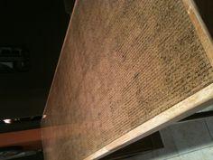 DIY bar top. Cork peel scrapbook sheets, frame it, pour on epoxy